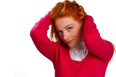 red-haired girl in a pink jacket isolated on a white - stock photo