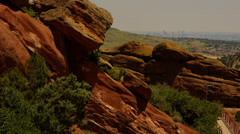 Red Rocks park and amphitheatre with Denver skyline on a hazy day Stock Footage