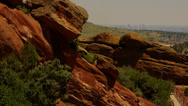 Stock Video Footage of Redrocks park and ampitheatre with Denver skyline on a hazy day