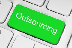 green outsourcing button. - stock photo