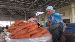Selling carrots at Samarkand bazaar Stock Footage