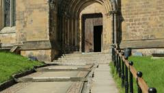 Tilt upwards of ripon cathedral steps to side door, england Stock Footage