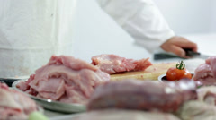 Butcher chopping turkey meat and removing useless parts - stock footage