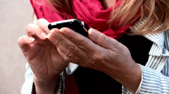 Woman on her phone Stock Footage