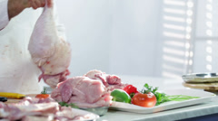 Butchery shop full of turkey meat while butcher working - stock footage