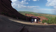Stock Video Footage of Timelapse of crowd arriving at Redrocks amphitheatre for concert.