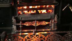 Pan heats on kitchen range in edwardian era living museum Stock Footage