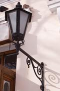 Wrought iron lamp on a weathered wall Stock Photos