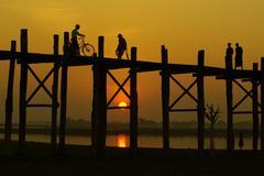 Sunset at u-ben bridge, amarapura, mandalay, myanmar Stock Photos