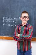 Eminent boy at chalkboard Stock Photos