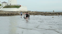 People caught by the incoming tide Stock Footage