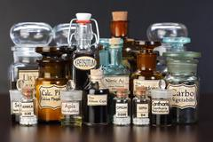 Various pharmacy bottles of homeopathic medicine Stock Photos