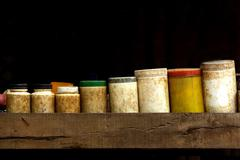 old medical containers on black background in provincial - stock photo