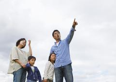 Family looking up at the sky - stock photo