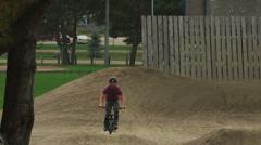 Ultra High Definition 4K - Extreme Sport - Biker doing wheelie on dirt moguls - stock footage