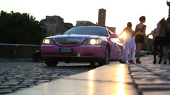 Pink stretched limo & Hen party 1 Stock Footage