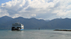 Ferry Boat Taking Cars and Trucks Stock Footage