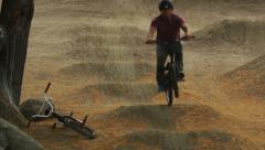 Slow Motion BMX Wheelie on Moguls - stock footage