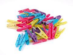 Multicoloured plastic clothes pegs. Stock Photos