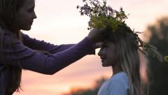 Silhouettes Two Children Girls with Flower Wreath on Nature at Sunset HD Stock Footage