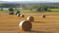 Tractor forming a hay bale Stock Footage