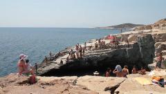 People on the rocks at seashore Stock Footage