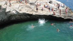 Girls jumping in lagoon Stock Footage