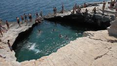 People jumping in Natural Water Pool Stock Footage