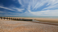 Time-lapse of the tide coming in, Camber sands, East Sussex, UK - stock footage