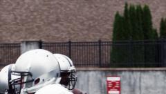 Football Quarterback Throws the Ball Stock Footage