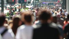 Anonymous crowd of people walking on city street sidewalk - stock footage