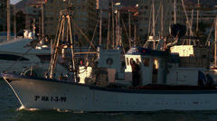 Trawler exits port to fish Stock Footage