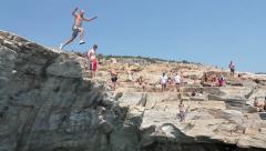 Man jumping in water, lagoon Stock Footage
