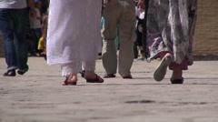 Feet and legs of Uzbek pilgrims Stock Footage