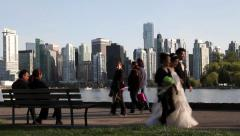 Groom and bride walking at Vancouver Stanley Park Stock Footage