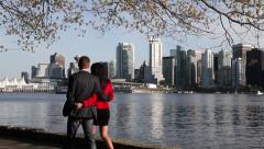 Couple walking at Vancouver's Stanley Park Stock Footage