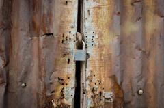 Rusty zinc door lock with key Stock Photos