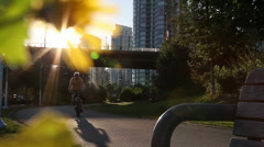 People cycling and rollerblading at the sunset 02 - stock footage