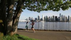 People exercising in Vancouver's Stanley Park Stock Footage