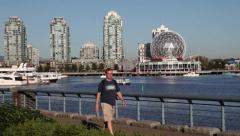 Man walking at False Creek Stock Footage