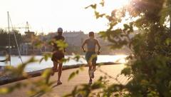 People jogging at Vancouver seawall Stock Footage