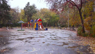 Stock Video Footage of Children's playground in the fall. It's snowing, Ekaterinburg, Russia