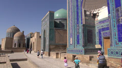 Pilgrims visit holy 'Shah-i-Zinda' shrine in Samarkand, Uzbekistan Stock Footage