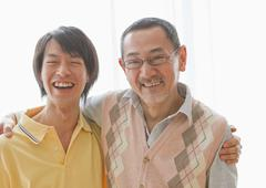 Smiling middle-aged man and senior man - stock photo