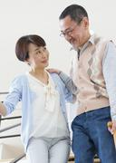 Senior woman supporting her husband - stock photo