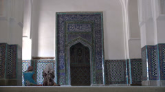 Two women pray in Shah-i-Zinda complex in Samarkand Stock Footage