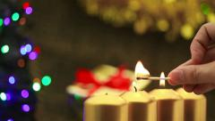 Hand lighting four christmas candles Stock Footage