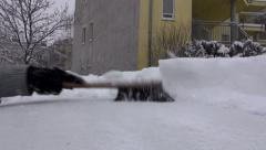Sweeping away snow from car roof Stock Footage