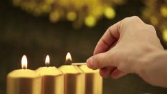 Hand lighting four advent candles Stock Footage