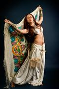Attractive retro model in old-fashioned wild clothing dancing Stock Photos